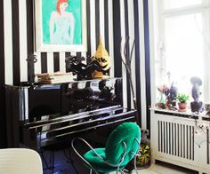 The White (and Black) Stripes: Artist Elvira Bach gives her spirited figurative paintings an otherworldly Alice-in-Wonderland-esque backdrop of bold black-and-white stripes and nostalgic red gingham. via @mydomaine