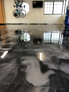 A close up of a two color grey metallic epoxy garage floor. Garage Floor Coatings, Garage Floor Epoxy, Epoxy Floor, Concrete Sealant, Jesus Artwork, Floor Colors, Interior Design Kitchen, Gray Color, Metallic