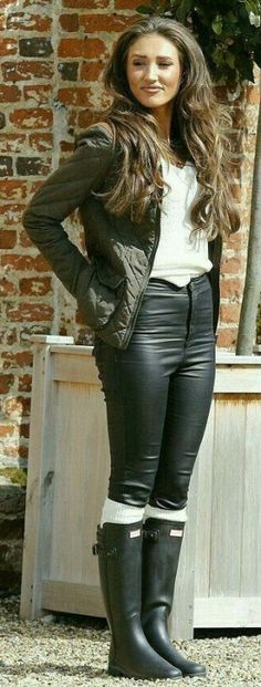 Leather pants, rubber riding boots with white socks