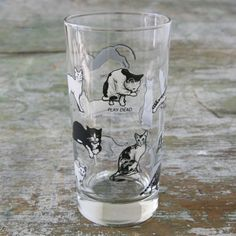 """The dogs obey. The cats...not so much! But this pattern will put any cat and dog lover in a tailspin!    Dimensions: 5-5/8""""H x 2-7/8""""W  Capacity: 12-1/2 oz Materials: Glass Dishwasher safe  Made in the USA Fishs Eddy Exclusive"""