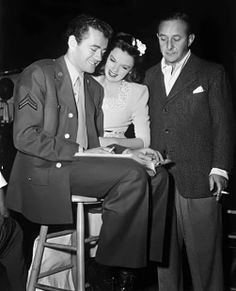 Robert Walker, Judy Garland and producer Arthur Freed on the set of The Clock