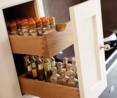 Great storage and organisation to reach things at the back of the cupboard, classic painted kitchen by Tom Howley