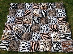 A totally different type of quilt from us!  Animal print puffy rag quilt by OliveStreetStudio, $85.00