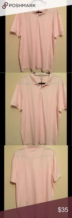 Men Pink and white stripes Calvin Klein pink and white stripes polo shirt.  Size: XL.    Material: liquid cotton which is extra fine yarns with lustrous finish for a cool, luxurious feel Calvin Klein Shirts Polos