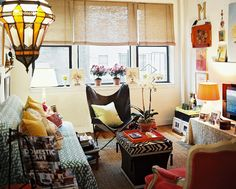 Bohemian Living Room Photo - A butterfly chair and a red armchair on either side of a zebra-print storage ottoman