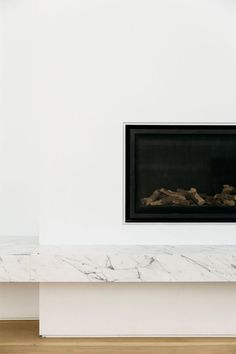 Marble hearth for fireplace, see also on this article the plain white tile with Carrara marble feature in shower for the upstairs bathrooms. Contemporary Fireplace Designs, Contemporary Stairs, Contemporary Apartment, Contemporary Wallpaper, Rustic Contemporary, Contemporary Garden, Contemporary Bathrooms, Contemporary Interior, Contemporary Architecture