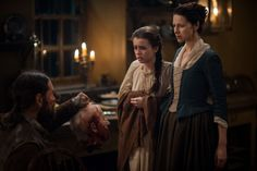 """Murtagh (Duncan LaCroix), Claire Fraser (Caitriona Balfe) and Mark Hawkins (Rosie Day) in Episode 211 """"Vengeance Is Mine"""" of Outlander Season Two on Starz"""