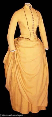 Circa 1897 lady's goldenrod yellow silk two-piece bustle gown.