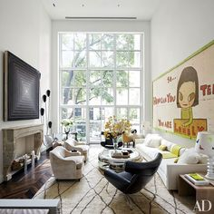 At this Manhattan home designed by Delphine Krakoff, an understated Didier Benichou rug allows the bold art and lush view to take center stage.
