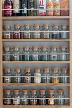 spice rack with cork topped bottles labelled with white paint pen Wall Spice Rack, Diy Spice Rack, Kitchen Spice Racks, Wooden Spice Rack, Spice Storage, Spice Jars, Spice Rack Plans, Spice Rack Organization, Kitchen Organization Pantry