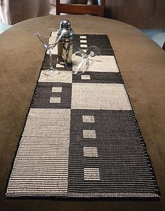 Manhattan Table Runners - this is a weaving project, but I think I could work it out as a shadow-knitting project. Very cool design.