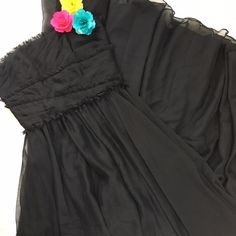 Monique Lhuillier Black Chiffon Gown This isn't a dress: this is GOWN! Classic and elegant, perfect for black tie weddings and events! Raw edged details are feminine and flattering, fully lined skirt has great movement to it! Monique Lhuillier Dresses