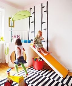 Ikea slide and indoor play area. blaine would have a heart attack if he came home to this one day. wish we had room for it!