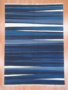 New Turkish Kilim Area Rug with blue and navy tones. This kilim is hand-woven in Konya, Turkey with vegetable-dyed and hand-spun wool.