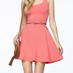 Express Stretchy Cotton Dress Coral stretchy skate dress. Bright splash of color for the spring! Great with a pair of wedges! Express Dresses Asymmetrical