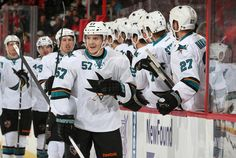 San Jose Sharks forward Tommy Wingels is congratulated by the Sharks bench after scoring a first period short-handed goal (Oct. 27, 2013).