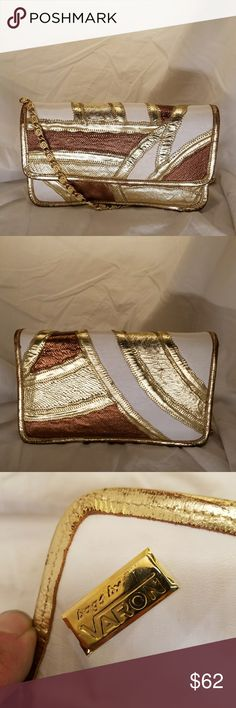 VARON vintage 70's clutch Vintage Varon patchwork clutch with chain shoulder strap. Excellent condition.  Snakeskin in platinum & copper with white leather.   This bag inspires me to get dressed up and go dancing! Now, that's pretty darned good for a bag! VARON Bags Clutches & Wristlets