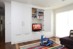 Custom designed units to hide the kiddies toys when you need. Walk In Wardrobe Design, Entertainment Units, Bed Wall, Storage Solutions, Home Office, Tall Cabinet Storage, Custom Design, Lounge, The Unit
