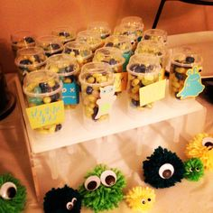Monster Themed Baby Shower.  Some push pops we put together and decorated with cricut monsters.  My friend made the little monster Poms from yarn