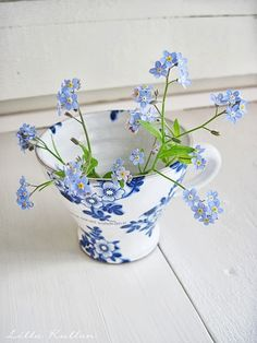 A porcelain cup of forget me nots