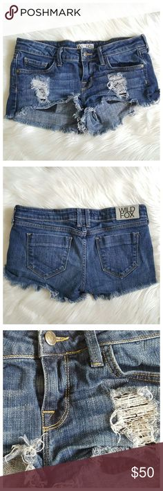Wildfox Distressed Denim Jean Shorts Low-rise 27 Short, low rise jean shorts by Wildfox, size 27. Stylish, cute distressed front with fringed, cut-off hemline look. Medium denim wash. Made in USA! Material: 98% cotton, 2% lycra. Pre-loved, overall great condition with minimal wear. Wildfox Shorts Jean Shorts
