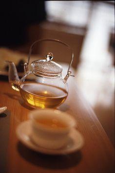 tea in a clear glass teapot