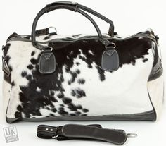 Black and White Cow Skin Leather Holdall Bag -   Stunning and very stylish black and white cow skin leather holdall bag.   The original soft fur cow skin exterior delivers a full authenticity and high-end finish. The chic black and white animal design adds an expensive designer feel and since it is all genuine leather then all that is missing is the expensive price tag.  All leather natural cow hide for good durability.  Ideal for weekends aw…