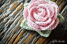 Free pattern: Crochet Rose.  Fast, easy. Added it to a crochet sun hat for my little one.