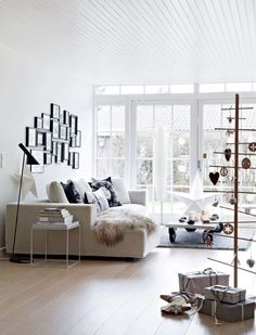 beautiful Danish living room and modern wooden Christmas tree