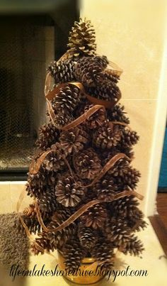 Pine cone tree tutorial.Embellish with mini lights, sprigs of pine cut off from dollar store garland, bits of red berries, use a little to create breath taking nature tree for in or out door display.