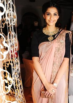 Sonam :) I like the high sari blouse with the choker necklace