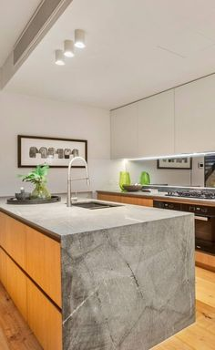 loving the texture on this concrete benchtop and slab end.  Home in Brighton East, Victoria | lighting design by Decrolux