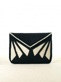 Felt Siba Nepal iPad Clutch: The profits from these unique bags, made by socially responsible, woman-focused artisan groups, will be invested in educating girls in the country where each bag was made. Buy a bag, employ a woman, educate a girl.