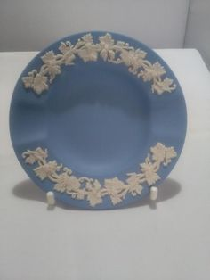 A lovely collectable ash tray from Wedgwood. This is in the blue jasperware ware with white bas relief flower garlands round the edges.It measures 9 centimetres across and is in lovely condition. Toast Rack, Leaf Border, Breakfast Set, Ivy Leaf, Flower Spray, Flower Garlands, Wedgwood, Ash, My Etsy Shop