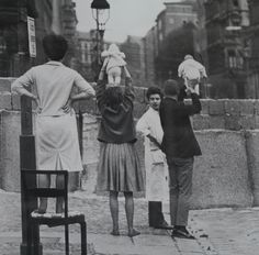 Residents of West Berlin show children to their grandparents who reside on the Eastern Side • 1961