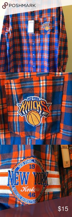 New York Knicks Men's Button Up Shirt New York Knicks Men's Button up shirt bKnicks logo on front pocket and sleeve. New York on back shoulders. Long sleeve  100% Cotton  New condition never worn still with NBA Store tags NBA Store Shirts Casual Button Down Shirts