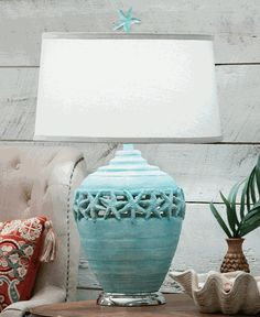 """Starfish Beach Table Lamp - $198.91 Featuring a light blue base accented by starfish cutouts, a round white linen shade, & a cute sea star finial, the Starfish Beach Table Lamp is perfectly suited to your seaside home. •Lamp: 17""""Dia. x 30""""H; Shade: 17""""Dia. Top x 19""""Dia. Bottom x 11""""H •Resin •Blue finish •Uses one 150-watt max medium base bulb •Round faux silk shade"""