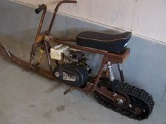 One of the members on this forum, Jeep2003, made a bike with snow blower tracks in the front and back and he used it year round. Description from oldminibikes.com. I searched for this on bing.com/images