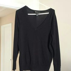 Lane Bryant Women's  Sweater Women's size 14 black v-neck sweater with 5 buttons at the bottom of each sleave. Gently worn. Pet and smoke free home. Lane Bryant Sweaters V-Necks