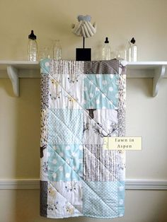 This Fawn in Aspen baby quilt is made from high quality cotton designer fabrics in aqua, white, tan, and taupe. You have a choice of backing fabric for this quilt: ~ either high quality organic cotton flannel in white ~ or super soft Minky Dot (photos 4 & 5) in your choice of color.