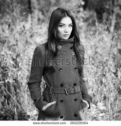 Portrait of young beautiful woman in autumn coat. Fashion photo. Black and white - stock photo