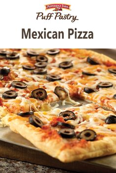 Puff Pastry Mexican Pizza Recipe.  What better way to spice up your pizza than adding some south-of-the-border inspired ingredients.  Top your flaky Puff Pastry with a salsa and pizza sauce mixture, mozzarella, cheddar and black olives for a zesty pizza that's perfect for any gathering.