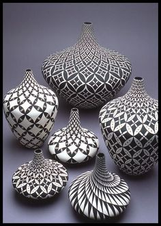 {Makes me want to draw tangles on pottery. Especially love the swirled pattern in lower right corner} Dorothy Torivio group. Acoma Pueblo pottery: