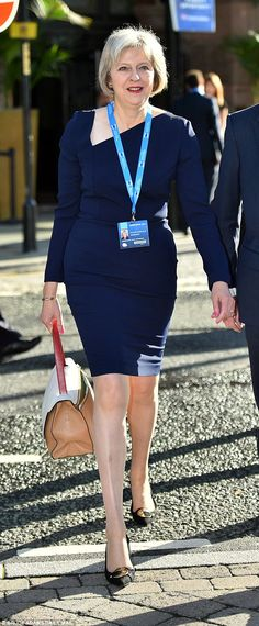 Theresa May arrived at the Conservative party conference in a striking Roland Mouret dress on Tuesday Dress Code, Teresa May, Love Fashion, Winter Fashion, Lawyer Fashion, Victoria Dress, Roland Mouret, Jeans Dress, Chic Outfits