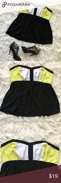 TORRID PLUS SIZE STRAPLESS TOP COLOR BLOCK TANK SUPER CUTE COLOR BLOCK STRAPLESS TOP! IT HAS GREAT STRETCH! ALSO A HAS A LINING TO HOLD THE BUST UP! NEVER BEEN WORN OR WASHED LIKE BRAND NEW WITHOUT THE TAGS! FIND THE HEELS IN ANOTHER LISTING! TORRID BRAND SIZE 3 torrid Tops