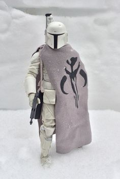 Custom cape for Black Series Prototype Boba Fett. You can't escape Fett even on a frozen desolate planet. This is a custom cape for the prototype Fett with the Bantha skull on it.