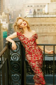 Amanda Seyfried for ELLE China  September 2016 wears a red and gold embroidered dress from PRADA
