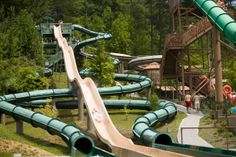 Dollywood's Splash Country - Get wet and wild at the Dollywood Splash Country water park, Tennessee's largest water park! Set in the beautiful Smokies, the water park features more than 30 rides and slides, including a white water rafting ride and body slide.