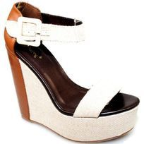 Step up to the mark in these gorgeous two tone open toe wedges. Featuring cream canvas style...