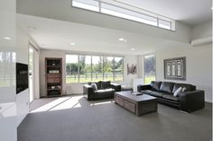 Living Room Design with Black Leather Couches